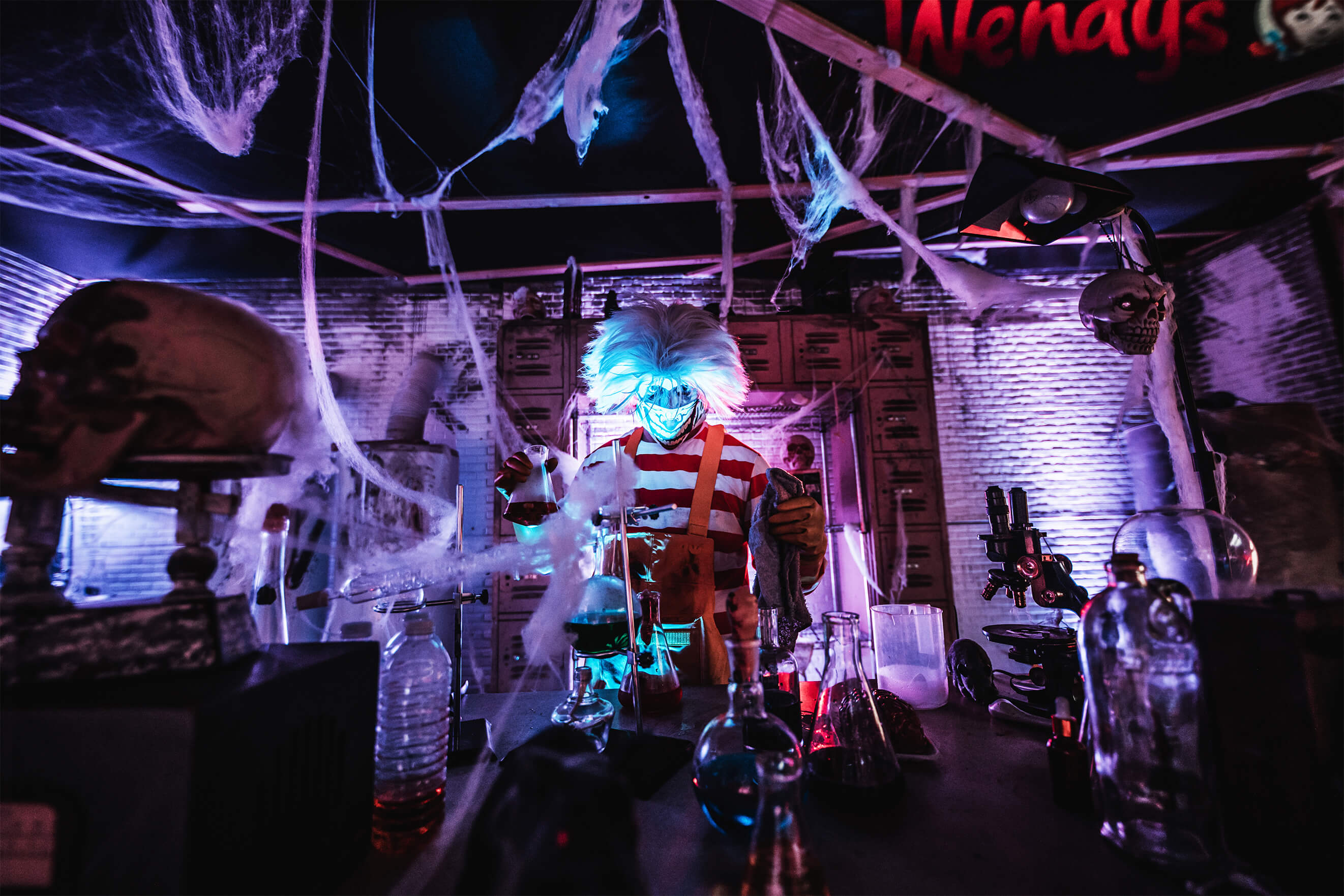 """A disturbing clown named """"Ron""""and other creepy competitor mascots could be found throughout the drive thru Halloween experience created by Wendy's and experiential marketing agency, TMA."""