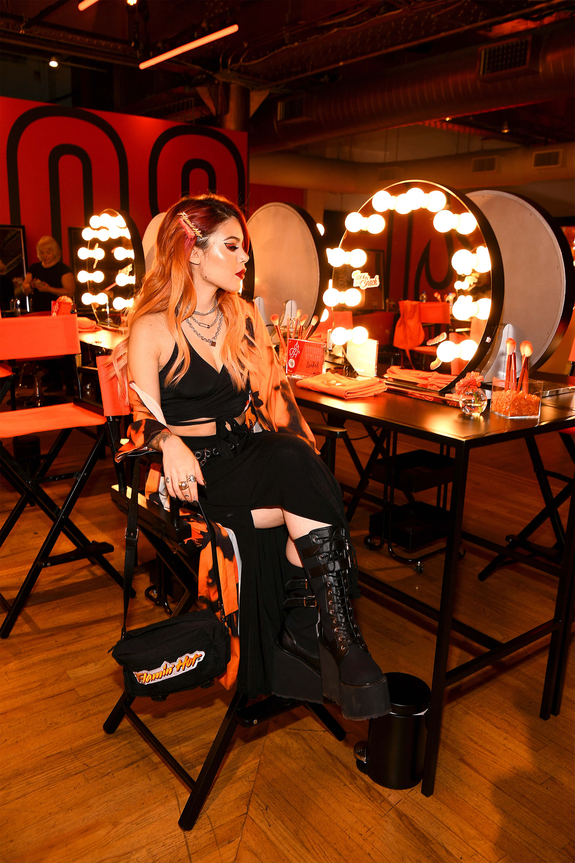 After the runway show, fans of the brand signed up for appointments at the House of Flamin' Haute Style Bar, where they received Cheetos-inspired hair, nail, and makeup looks from Chester Cheetah and a team of professional stylists.