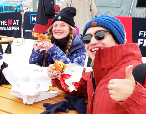 Skiers enjoying our sports marketing team's creative pop-up restaurant at 9000ft in the Rockies.
